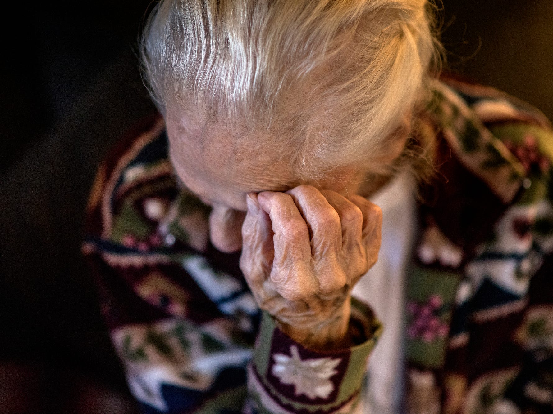 A frustrated Lois Faggion holds her hand to her head as she talks about her rat invasion on Tuesday, Sept. 25, 2018, at her home in Lansing. She says she needs help getting the rodents removed from her home. The house has not been maintained as well as it once was since her husband Bob died 20 years ago.