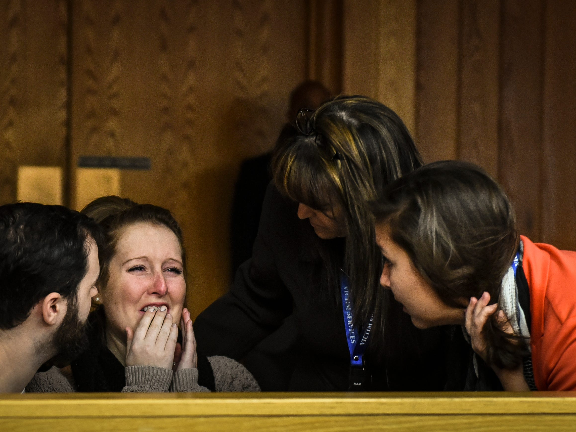 People react after an upset father tried to attack Larry Nassar after two of his daughters gave their victim impact statements Friday, Feb. 2, 2018, in Eaton County Circuit Court in Charlotte, Mich.