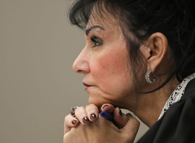 Ingham County Circuit Court Judge Rosemarie Aquilina listens to victim testimony Friday, Jan. 19, 2018, during the fourth day of victim impact statements in the sentencing of former sports medicine doctor Larry Nassar, who pleaded guilty to seven counts of sexual assault in Ingham County, and three in Eaton County.