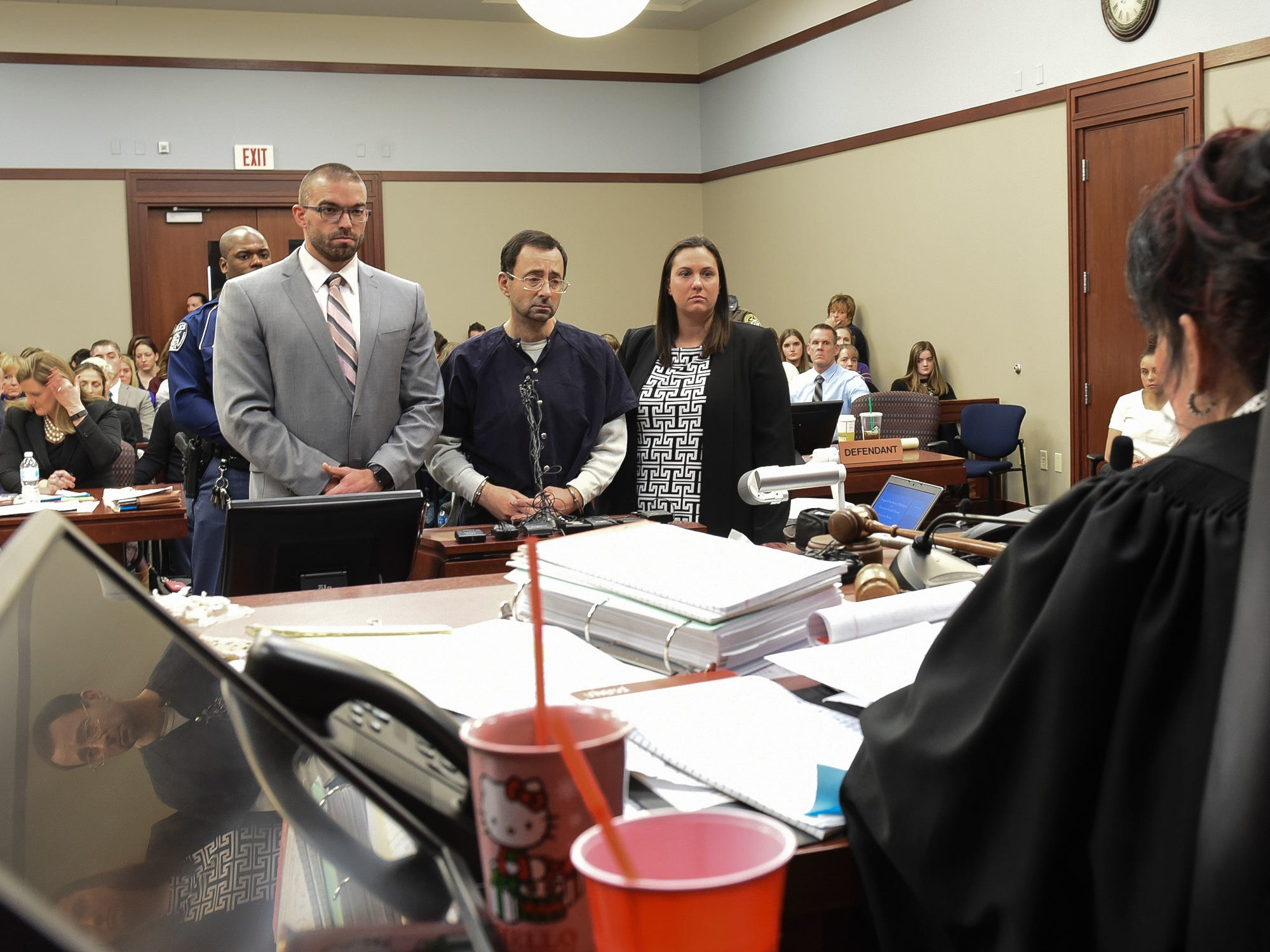 Larry Nassar faces Ingham County Circuit Judge Rosemarie Aquilina moments before his sentencing Wednesday, Jan. 24, 2018, after the seventh day of victim impact statements in Ingham County Circuit Court.  Nassar is flanked by his defense team Matt Newburg and Molly Blythe.