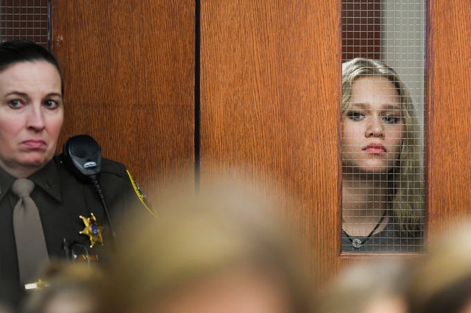 Kaylee McDowell, right, a Larry Nassar sexual assault survivor, peeks into Circuit Judge Rosemarie Aquilina's courtroom, Friday, Jan. 19, 2018, prior to giving her victim impact statement where she confronted Nassar during the fourth day of victim statements.  Nassar pled guilty to 10 counts of sexual assault in two counties.  He also pled guilty to possession of child porn in Federal Court.