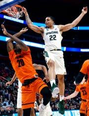 Michigan State's Miles Bridges, right, dunks over Bucknell's Nana Foulland during the second half on Friday, March 16, 2018, at the Little Caesars Arena in Detroit. The Spartans beat Bucknell 82-78 to advance to the second round in the NCAA tournament. Lansing State Journal photographer won second place for a sports photo in the Michigan Press Association 2019 Better Newspaper Contest.