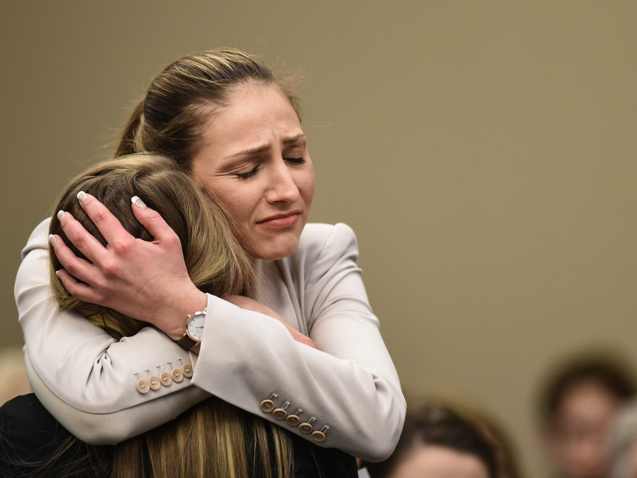 Kyle Stephens hugs Emily Morales after Morales gave her victim impact statement, Tuesday, Jan. 23, 2018, during the sixth day of victim impact statements in Ingham County Circuit Court.  Nassar is expected to be sentenced on seven sexual assault charges this week.