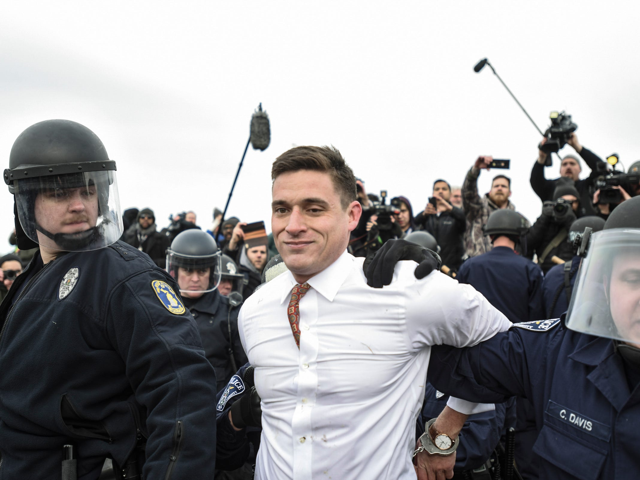 Richard Spencer ally Gregory Conte is taken into custody Monday, March 5, 2018, outside of the MSU Pavilion, where hundreds of protesters gathered to block Richard Spencer supporters from gaining entrance.