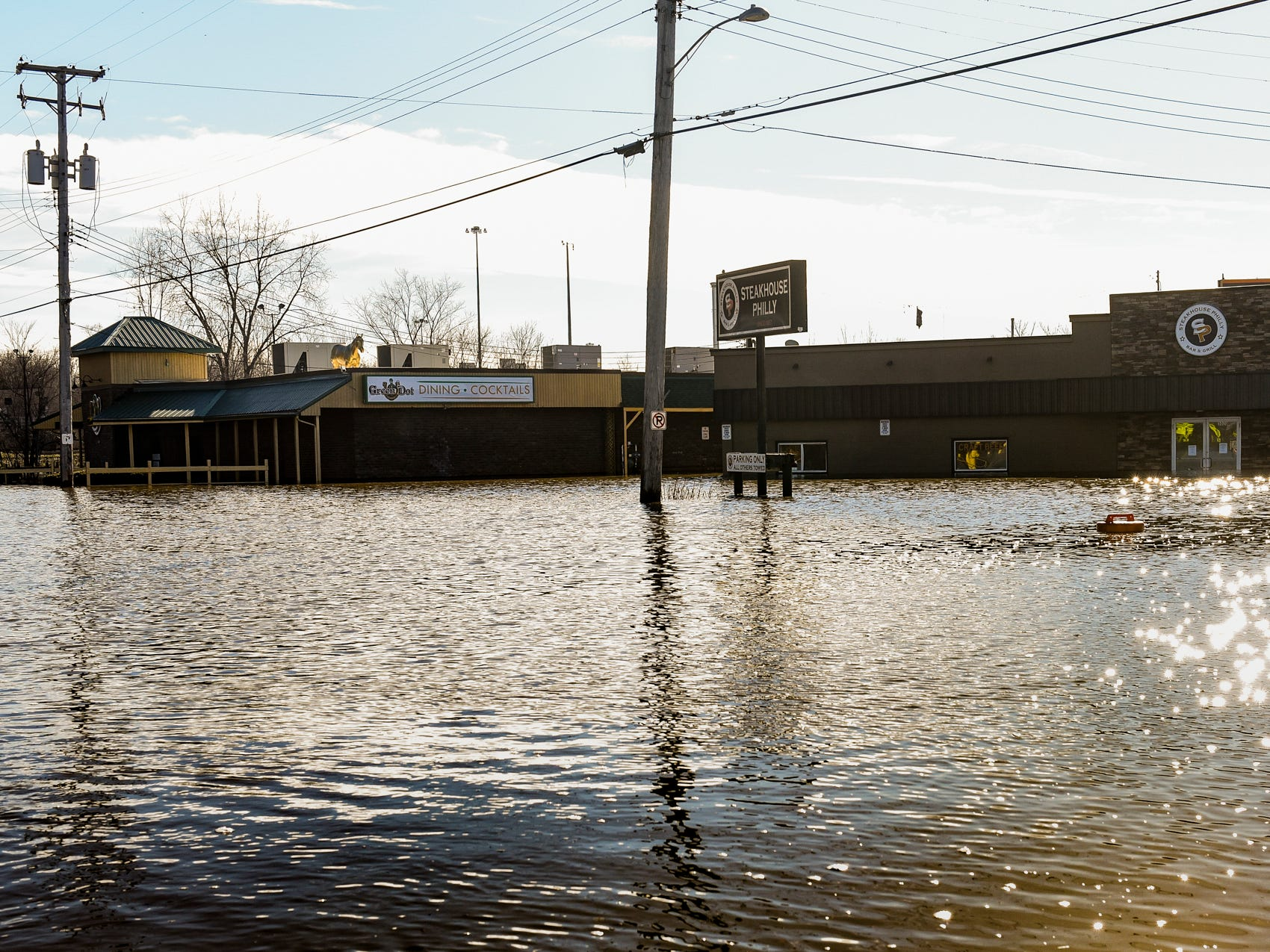 The Green Dot and Steakhouse Philly near Frandor Shopping Center are under water due to flooding Thursday, Feb. 22, 2018.