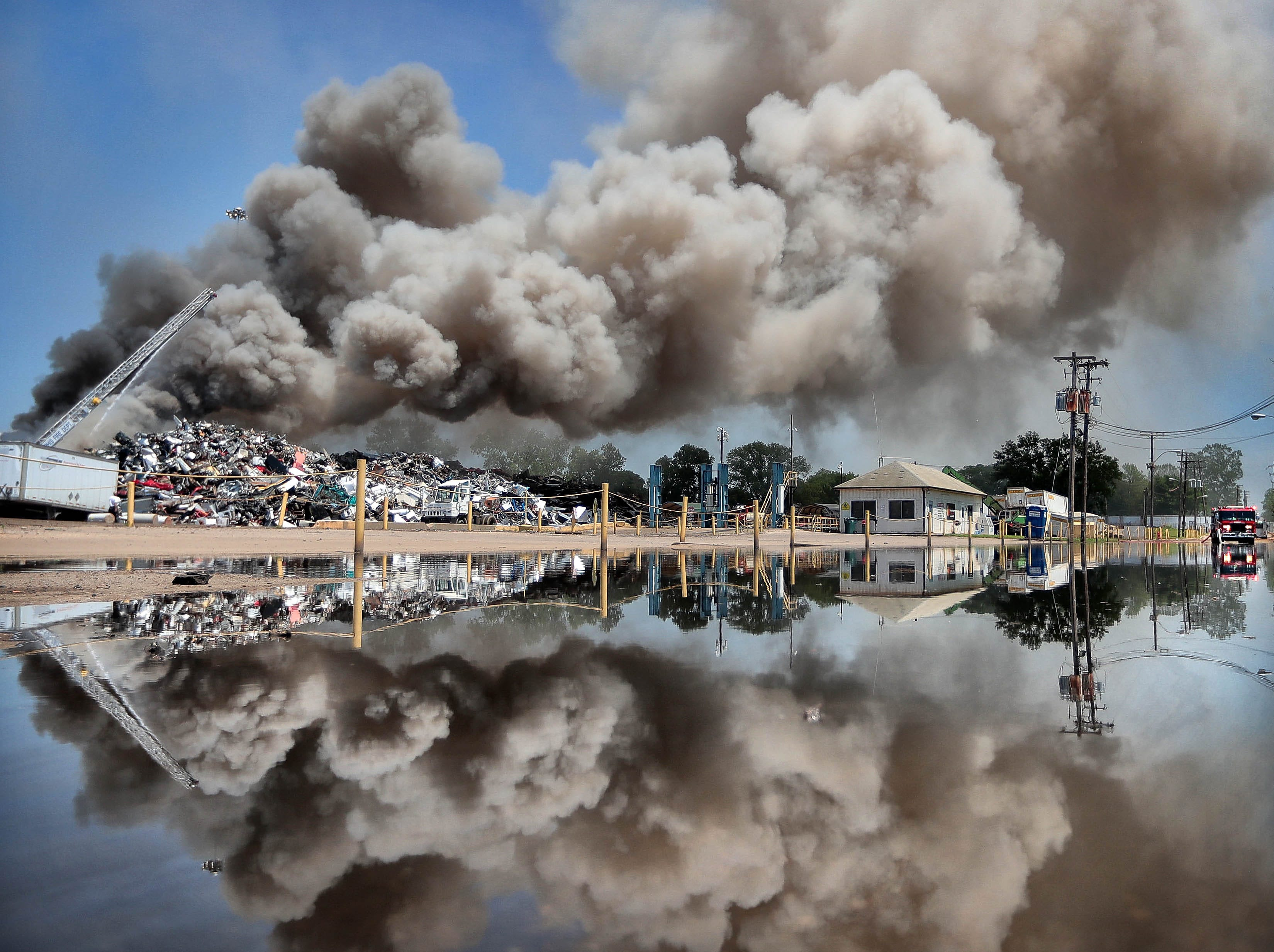 Memphis Fire Department crews battle a stubborn fire Sunday at a metal recycling business north of Downtown. The department sent multiple crews to the fire at Omni Source, but struggled to contain the blaze that continued to flare up with small explosions most of the day.