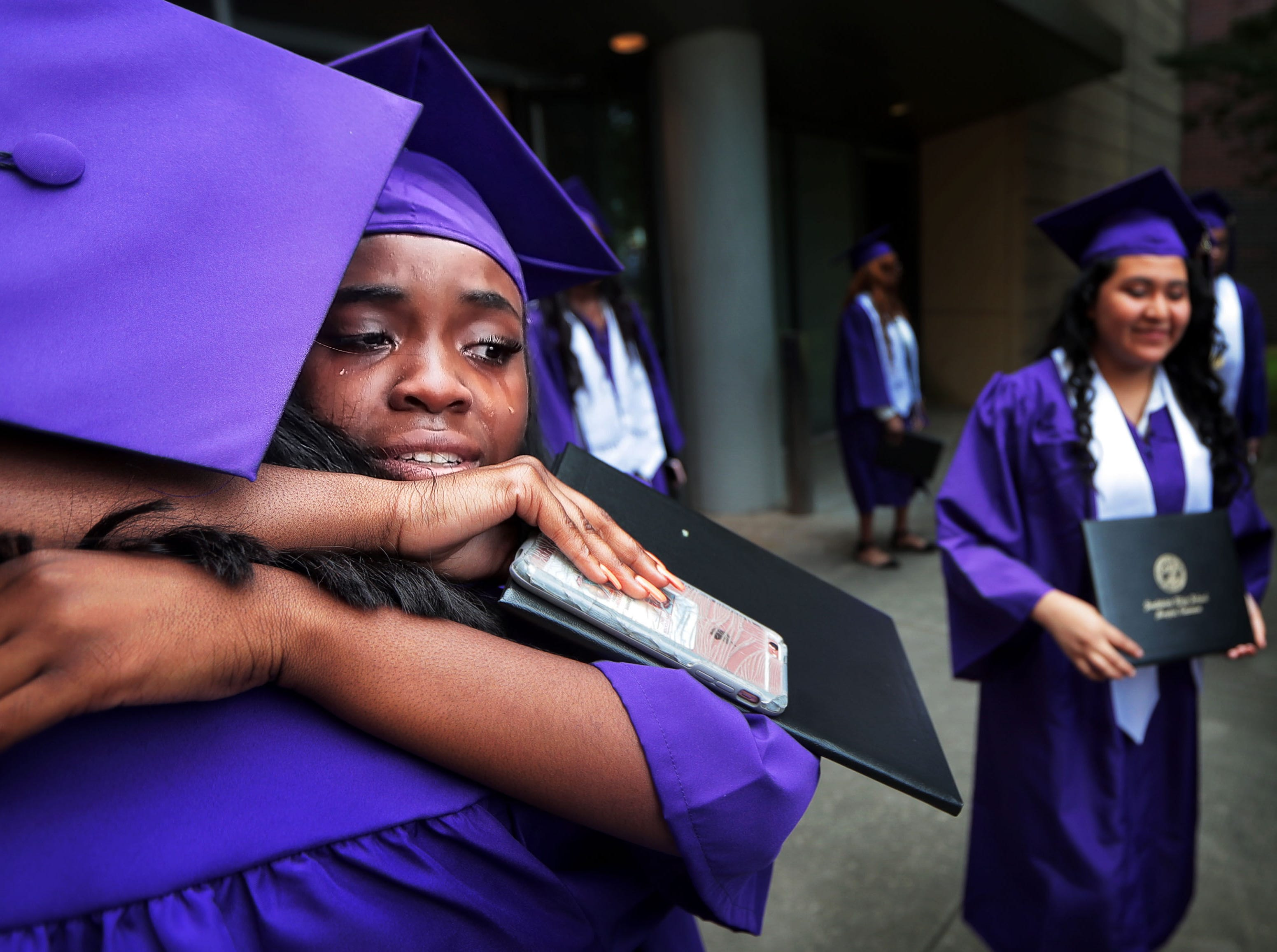 Darne Cooper and Jayde McClendon embrace Sunday morning as Southwind High School grads and their families gather at the packed Cannon Center to celebrate the graduation of 319 seniors.
