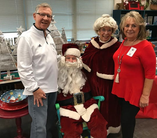 John Coff, Santa, Mrs. Claus, and Marie Lynn McChesney.