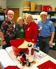 Rob Reiley, Keely Stiner, Diana Dohm, and Preston Stiner help with the gifts.
