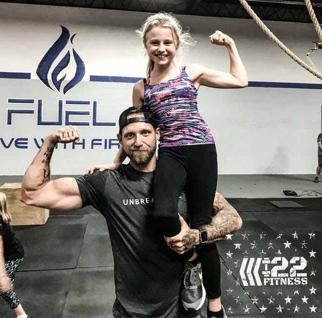 Army veteran Dan Newberry of Hales Corners teaches a free fitness class at 11 a.m. Sundays at FUEL Fitness in Oak Creek. This is Newberry with his daughter Chloe.