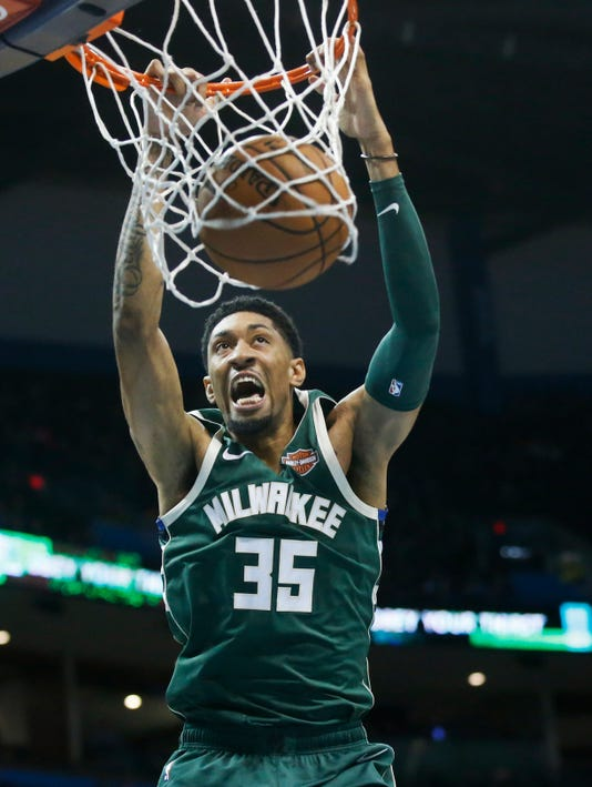 31e93c5e851 Milwaukee Bucks forward Christian Wood (35) dunks in the third quarter of a  preseason NBA basketball game against the Oklahoma City Thunder in Oklahoma  City ...