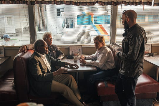 "Director David Lowery (right), a Waukesha native, talks over a scene with actors Danny Glover (from left), Tom Waits and Robert Redford on the set of ""The Old Man & the Gun."""