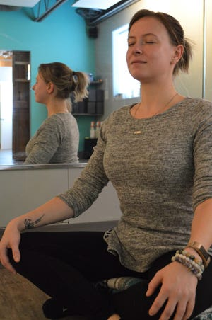 Yoga instructor Crystal Faron of Get Hot Yoga in Wauwatosa shares tips on how to be more mindful in the new year.