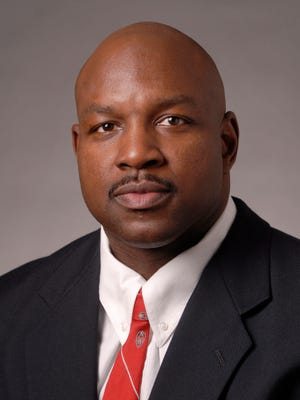UW assistant football coach John Settle.