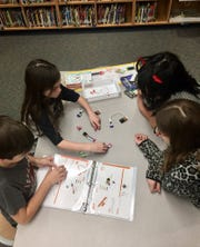 Hackler Intermediate School students work on an EAST project in the school's MakerSpace area.