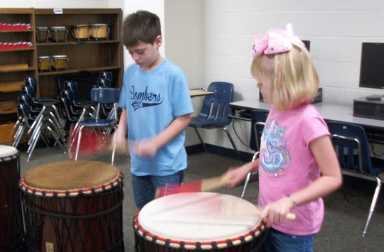 "Students from Nelson Wilks Herron Elementary school play the ""Dancing Drums"" in Tim Nelson's music class."