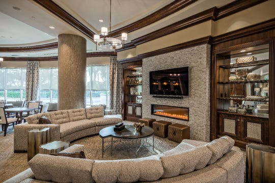 In the Social Room they renovated an existing TV wall system by removing the center and replacing with a stacked-stone product and fireplace.