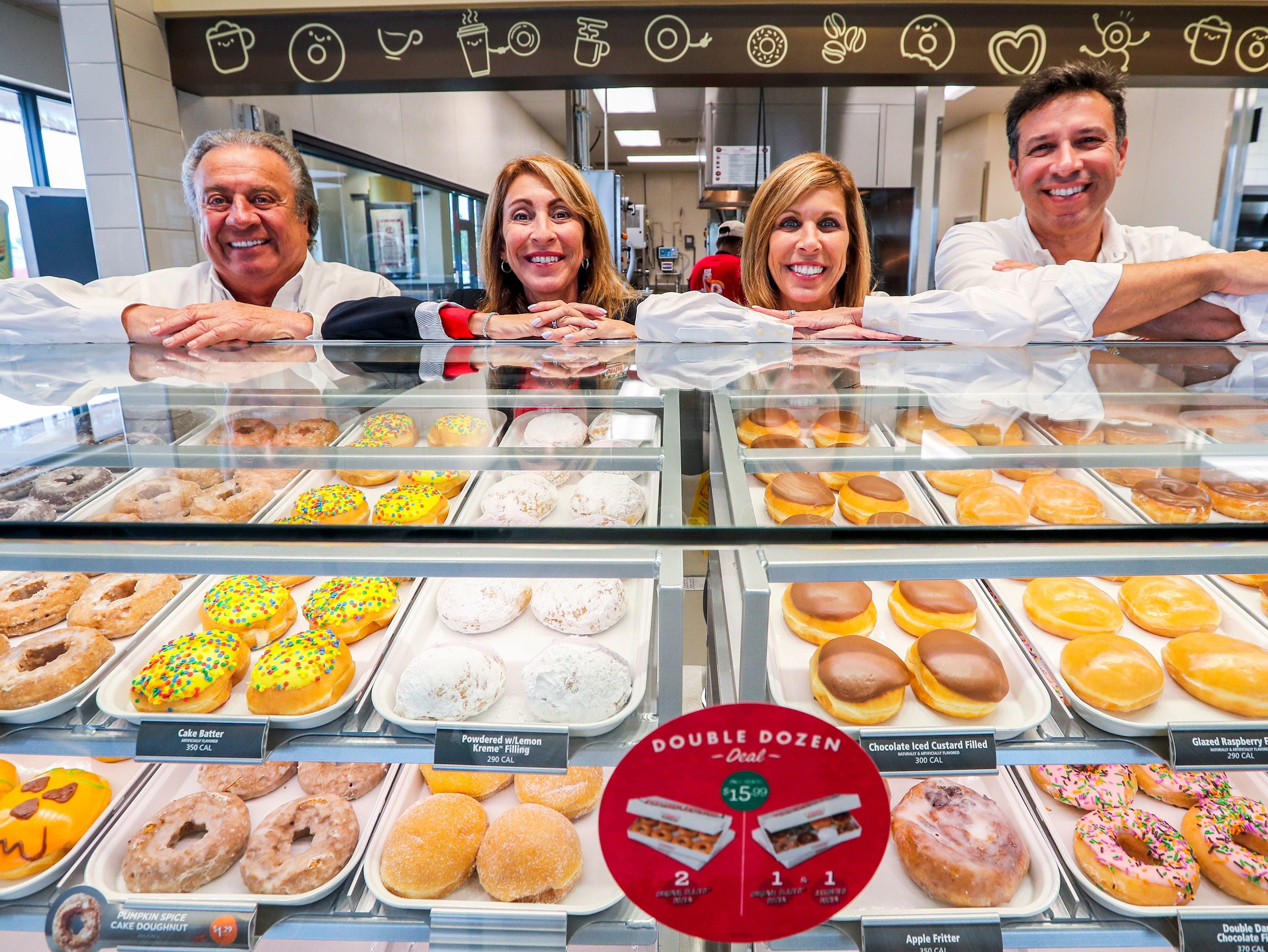 Krispy Kreme franchise owners, from left, Jim Cosentino; his daughters, Marialana Lococo and Jeanine Cieri; and his nephew, Chris D'Angelo opened their long-anticipated Fort Myers store in mid-October 2018.