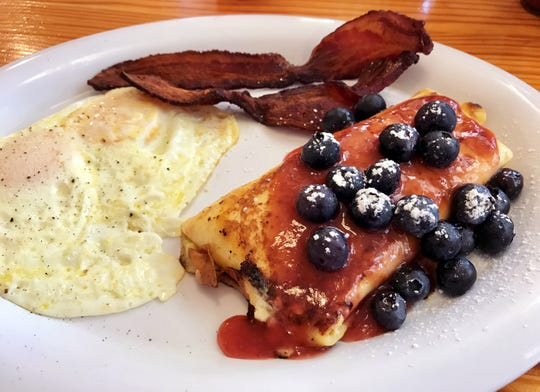 The Blintz Platter from Skillets with two eggs, two slices of bacon and a Chicago-style blintz.