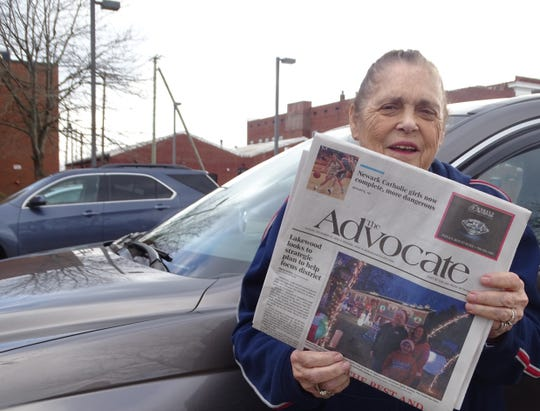 Hannah Partridge holds a copy of The Advocate. She retired from delivering the paper after more than 35 years on her routes.
