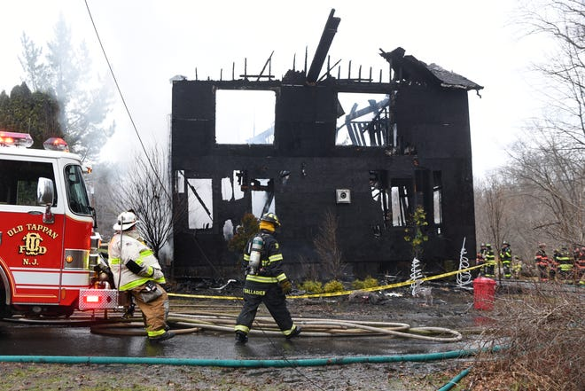A fire destroyed a house at 12 Grant Ave. in Old Tappan on Wednesday morning December 26, 2018. All the residents including Angelo and Theresa Mazza, their one-year old twins Rocco and Marco and Theresa's sister Maria Foti, who spent the night, escaped without injury. The Old Tappan fire department received mutual aid from surrounding fire departments including, Norwood, Tappan and Harrington Park.