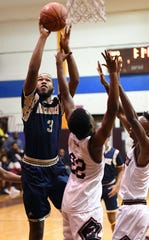 Jingle Bells Jubilee boys basketball tournament at Don Bosco Tech Academy in Paterson on Wednesday, December 26, 2018. Hackensack vs. Kennedy. H #3 Jelani Carter drives to the basket.