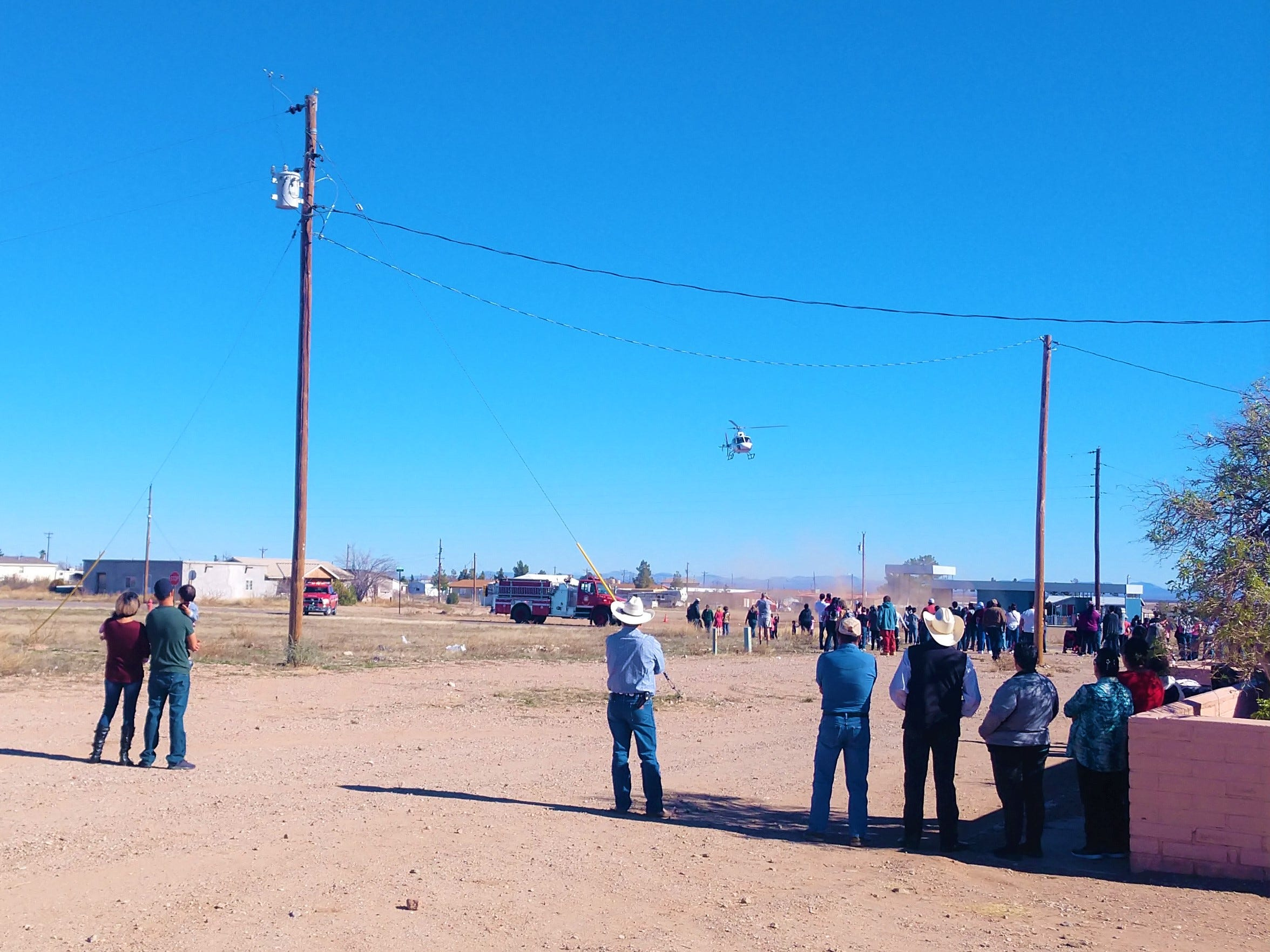 Families from the Village of Columbus gather to see Santa Claus arrive by helicopter.