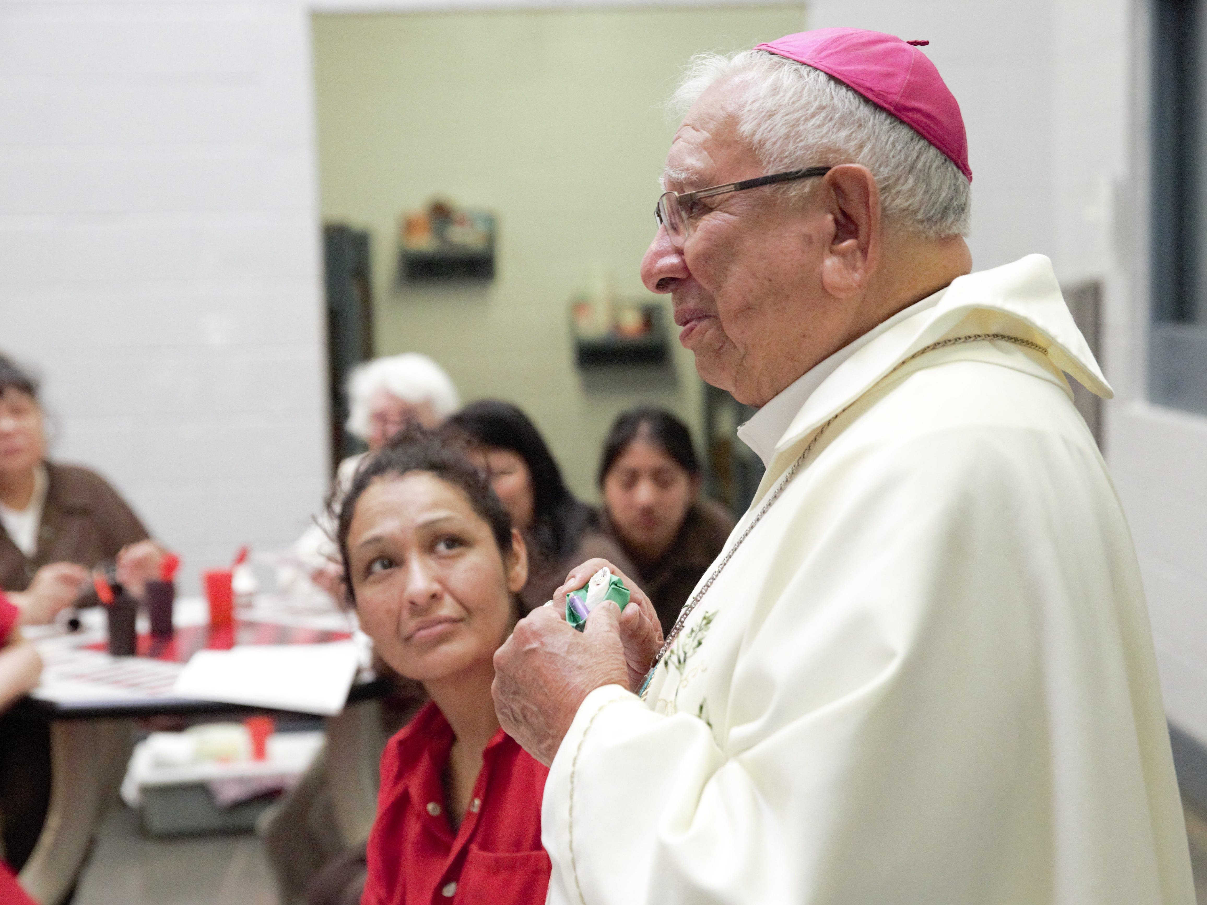 A detainee listens to a Christmas Day address by Bishop Emeritus Ricardo Ramírez on Tuesday, Dec. 25, 2018 in the Doña Ana County Detention Center.