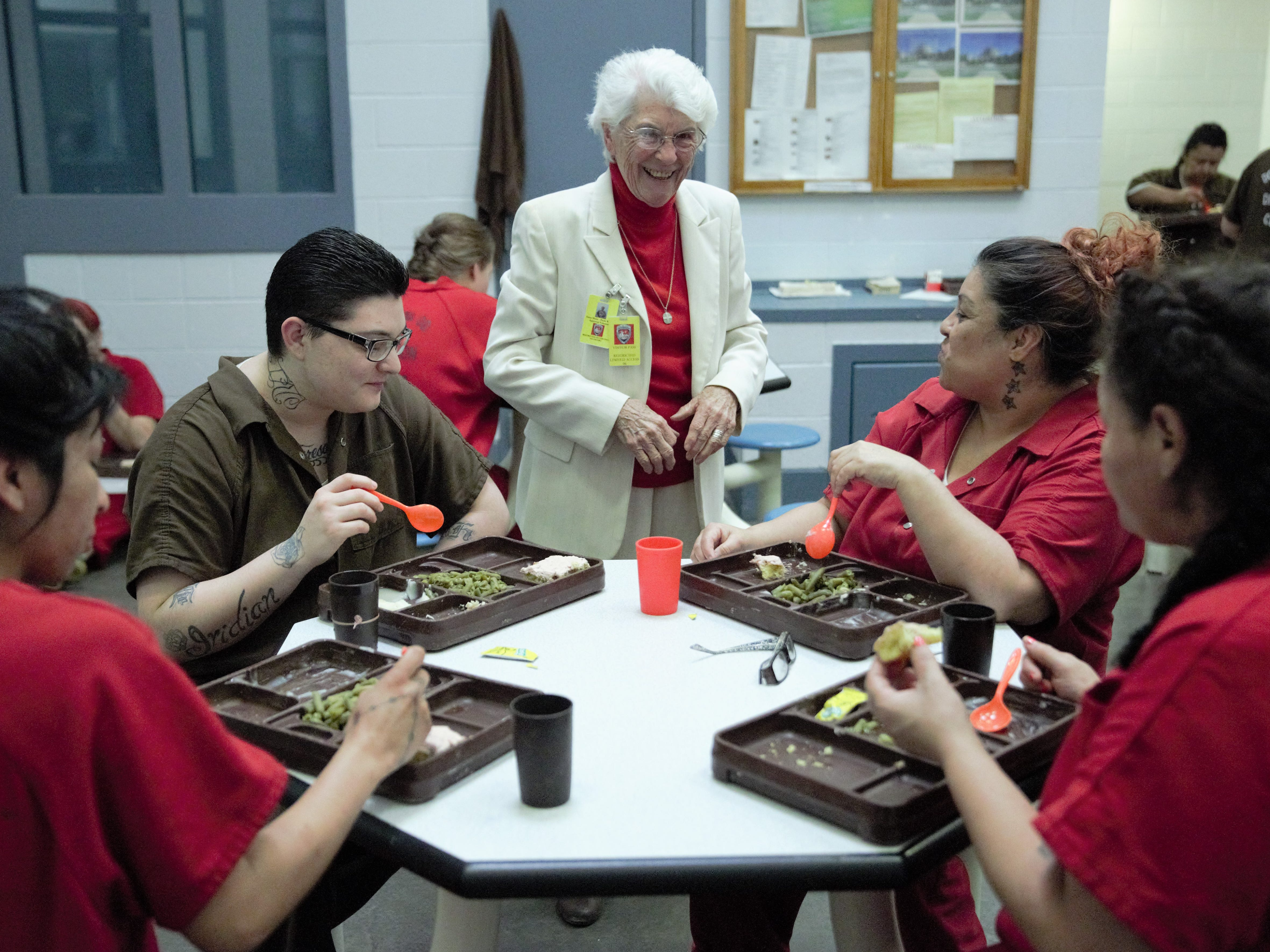 A group of women inmates at the Doña Ana County Detention Center finishes a Christmas Day lunch on Tuesday, Dec. 25, 2018, as Sister Marie-Paule Willem and two other visitors arrive to host a Christmas church service.