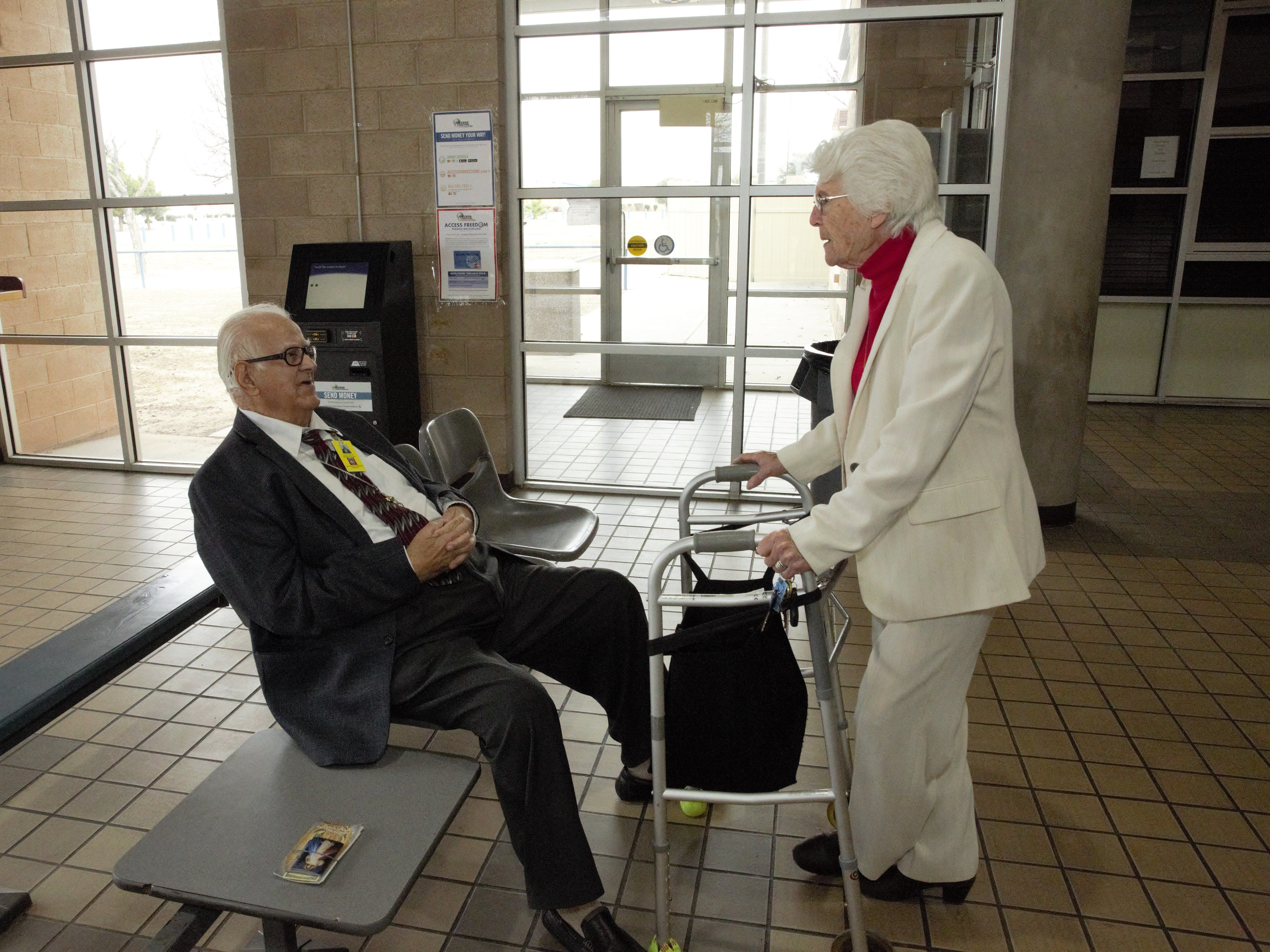 Volunteer Frank Ontiveros, left, and Sister Marie-Paule Willem chat on Tuesday, Dec. 25, 2018 in the lobby of the Doña Ana County Detention Center prior to visiting inmates for Christmas Day.