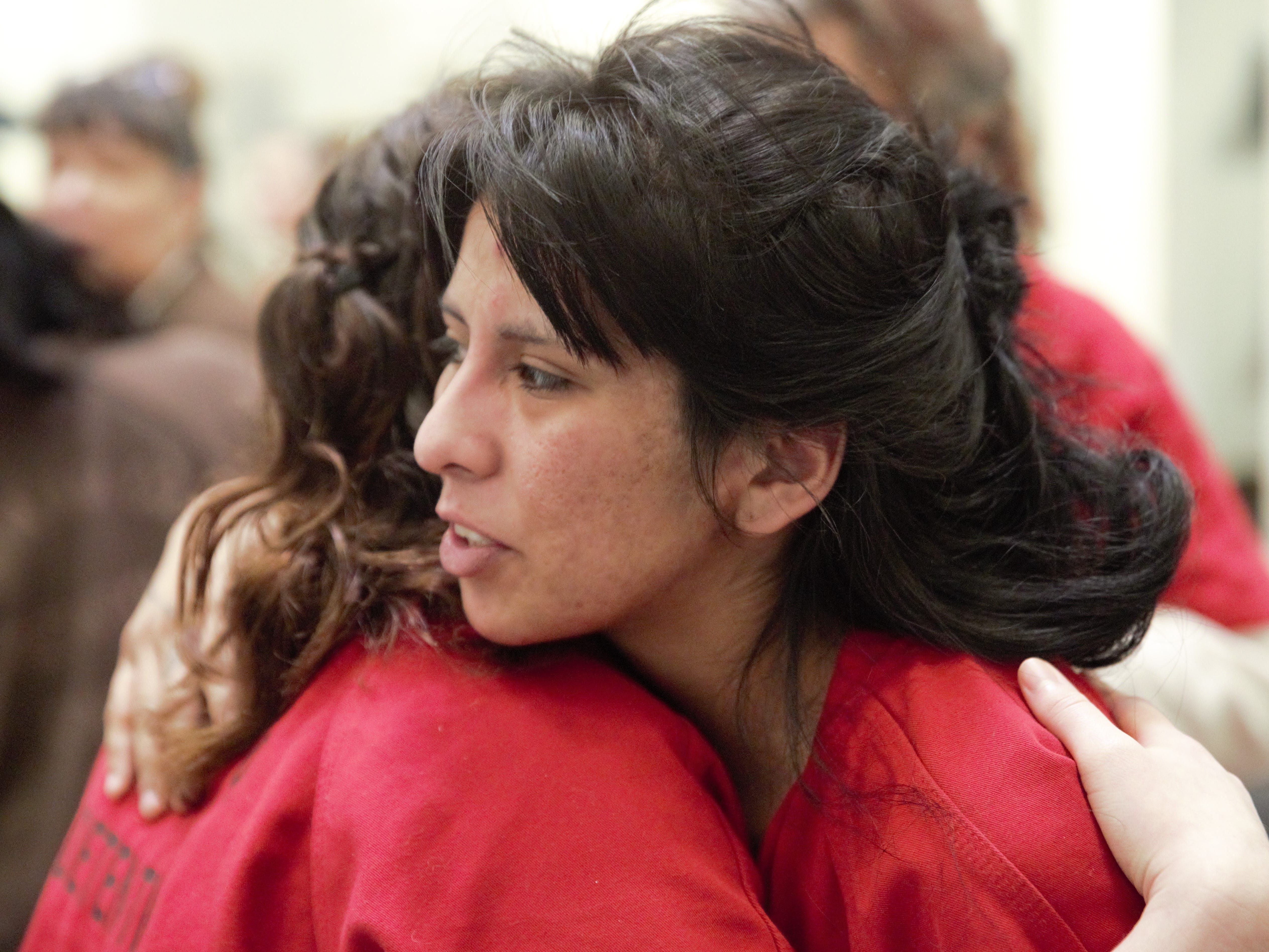 Two inmates hug at the close of a Mass service on Tuesday, Dec. 25, 2018 in the Doña Ana County Detention Center, 1850 Copper Loop, Las Cruces.
