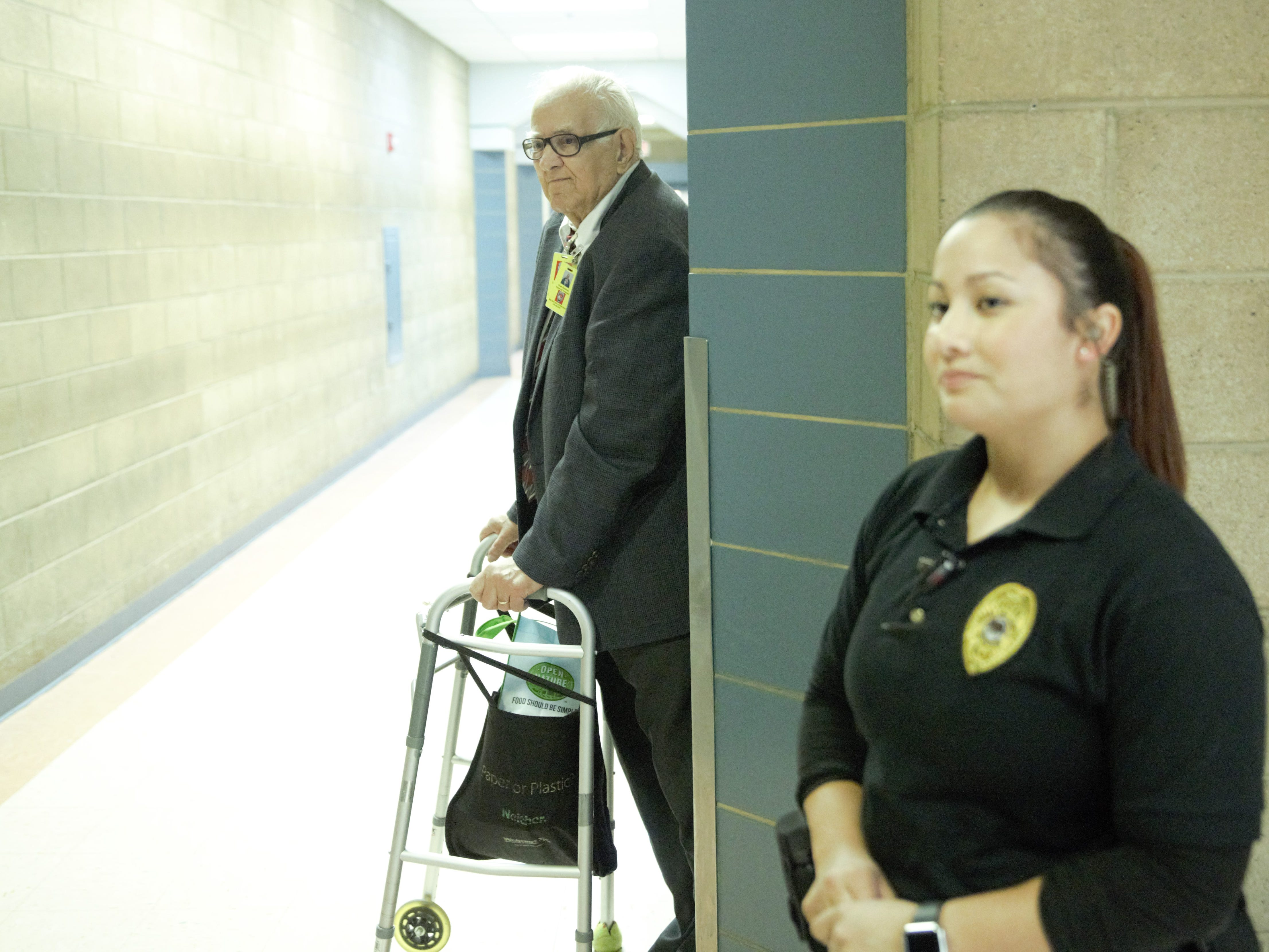 Frank Ontiveros, 86, says he has been regularly visiting inmates in the Doña Ana County Detention Center for 26 years as a volunteer with the Catholic Church. Detention Center officer C. Gomez, right, escorted Ontiveros, Bishop Emeritus Ricardo Ramírez and Sister Marie-Paule Willem through the facility on Tuesday, Dec. 25, 2018.