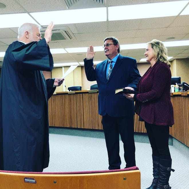 New Mexico Supreme Court Justice Gary Clingman swears in New Mexico District 41 Senator Gregg Fulfer. Fulfer was accompanied by his wife Kim Fulfer who held the Bible during the occassion.