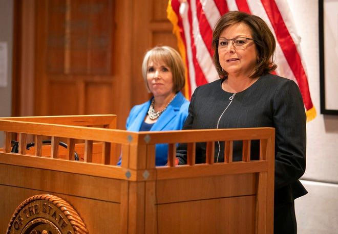In this Nov. 9, 2018, file photo, New Mexico Gov. Susana Martinez, right, and U.S. Rep. Michelle Lujan Grisham, who was elected in November as the state's next governor, hold a joint press conference following a meeting at the State Capitol in Santa Fe, N.M. Martinez, a Republican and the state's first female governor, has served two consecutive terms. Lujan Grisham, a Democrat, will take office Jan. 1, 2019.