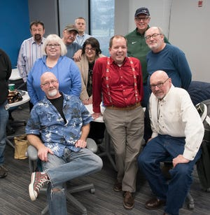 Most of the retiring Hometown Life journalists pose with Consumer Experience Director Phil Allmen, who is not retiring. Pictured in front are: Dan Dean and Bill Bresler; standing behind them are LeAnne Rogers (left), Phil Allmen and Bill Emerick; in back are Darrell Clem, Marty Budner, Matt Jachman, Sharon Dargay and Brad Emons. Also retiring but not pictured are Brad Kadrich and Tim Smith.