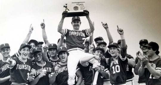 Emil Majeski holds up the 1984 MHSAA Class B state championship trophy after a 2-1 victory in the finals over Wyoming Park.
