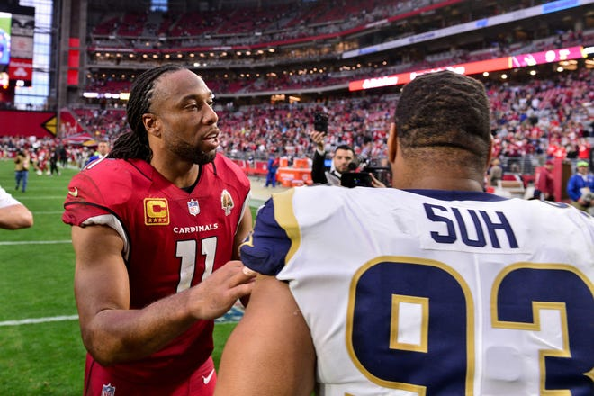 Arizona Cardinals wide receiver Larry  Fitzgerald (11) and Los Angeles Rams nose tackle Ndamukong Suh (93) talk after the game at State Farm Stadium.