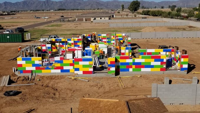 The neighborhood leading to the Lego-like house is currently under construction north of Luke Air Force Base by a few miles and east of the 303 at Peoria.