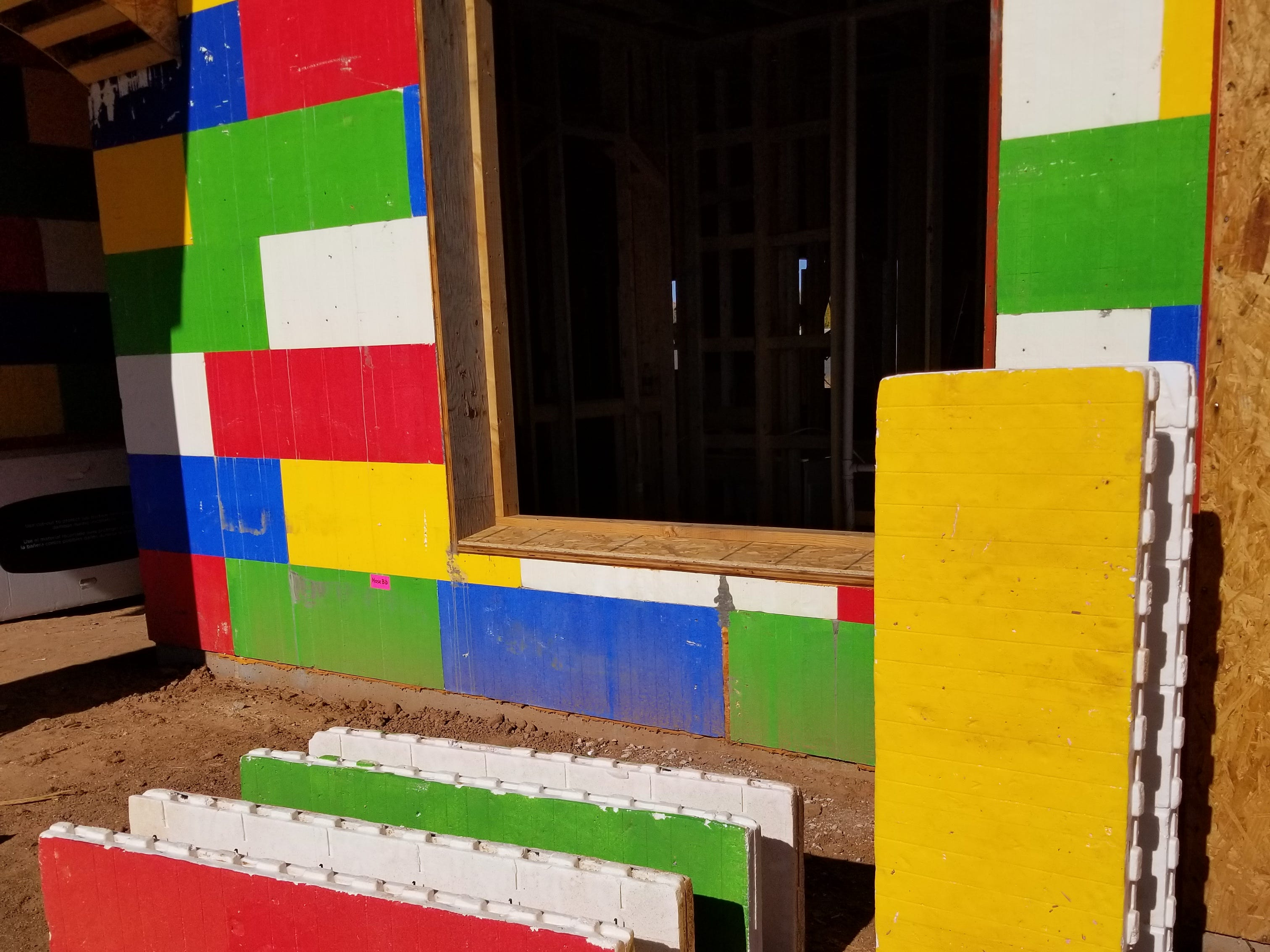 Demo insulating concrete forms in bright Lego-like colors are available for the curious to see up close when visiting the job site.
