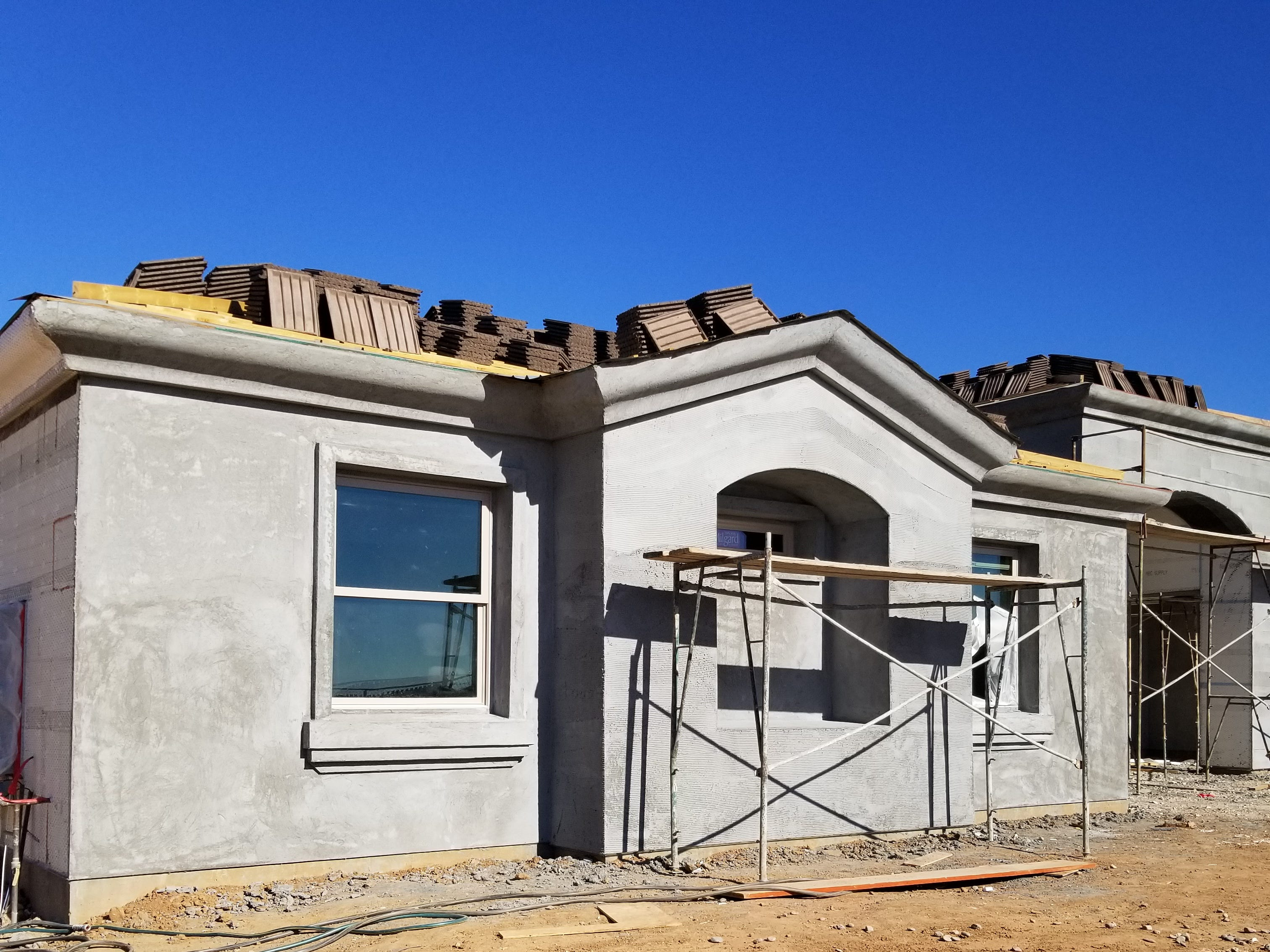The home next door is also a Castle Rock insulating concrete forms construction, minus the color block, but in a later stage of construction. Finishing touches give no evidence of the protection, safety features and R-40 insulation that lies beneath.