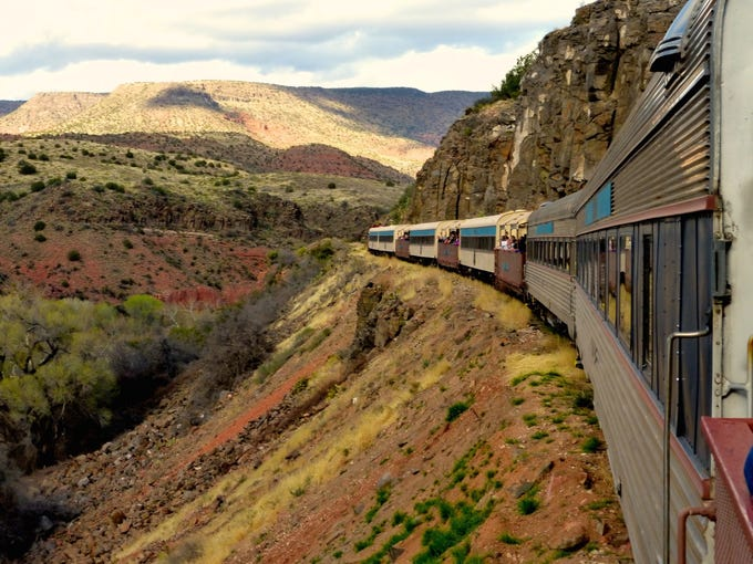 Verde Canyon Railroad rolls through a lush riparian corridor in a high-walled gorge on its four-hour journey.