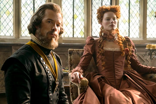 "Guy Pearce as William Cecil, left, and Margot Robbie as Queen Elizabeth in ""Mary Queen of Scots."" The movie opens Friday, Dec. 28, at R/C Hanover Movies."