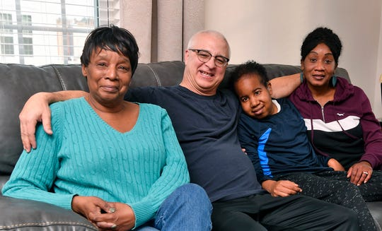 Giovann Green and his family, grandmother Mozell Jameson, left, step-father Tim Glackin, and mother Lashon Green-Glackin, right, will be traveling to Baltimore to meet his favorite WWE wrestler, John Cena, Friday. Green, 25, is battling brain cancer for the second time and Heartland Hospice set up the meeting for the Spring Garden man. Thursday, December 26, 2018.