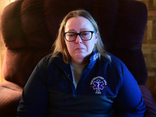 Amy Alexander fights back the tears as she reminisces about her father, Robert Kohler Sr., December 26, 2018.