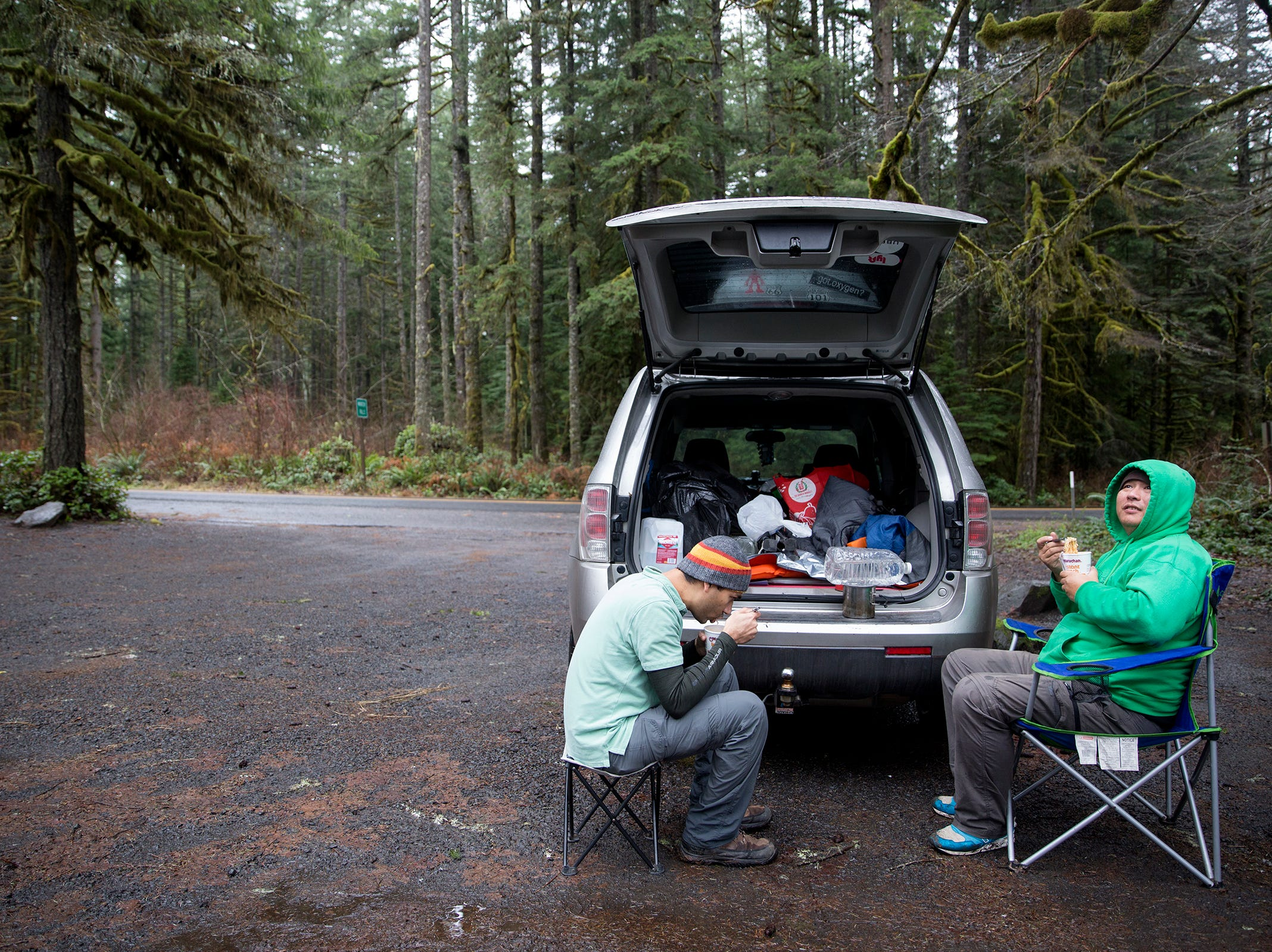 Prakash Jij and Richard Leu, from California, stop to eat Ramen noodles at Silver Falls State Park in Sublimity on Wednesday, Dec. 26, 2018. The two are on a road trip to see different state parks around Oregon.