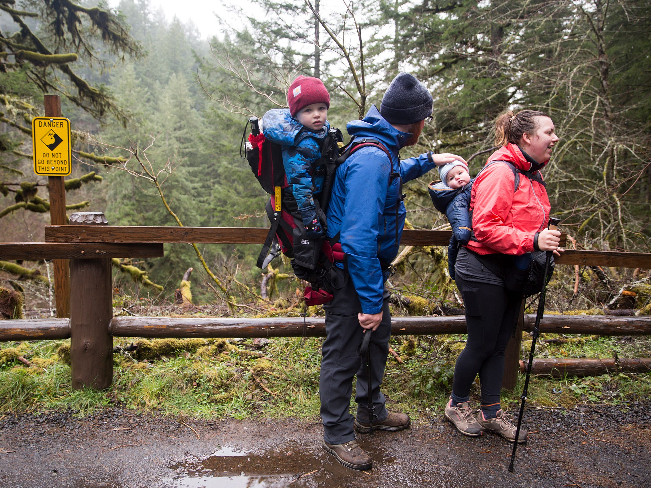 Seattle, Washington natives Teddi Dickerson, John Dickerson and their sons two-year-old Cooper and five-month-old Taylor take a break during a hike through South Falls at Silver Falls State Park in Sublimity on Wednesday, Dec. 26, 2018.