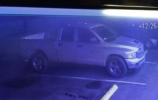 Authorities are looking for an extended cab pickup as they search for the suspected shooter of a Newman officer.