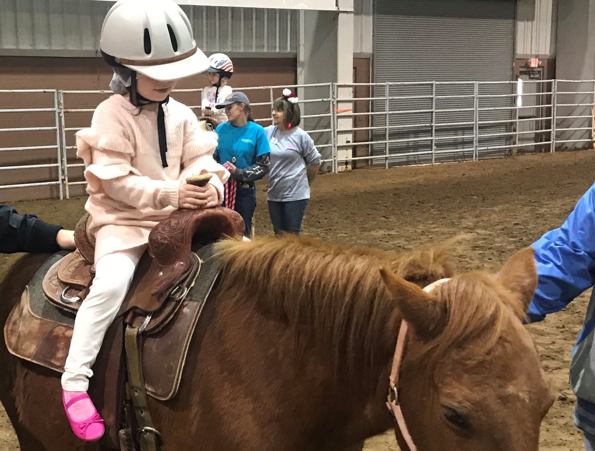 Kaya Knight rides Cricket on Dec. 25, 2018 during the Hope, Love and Horses event hosted by Sonrisas Trails and Stone Arbor Farms at 1st Community Federal Credit Union Spur Arena.