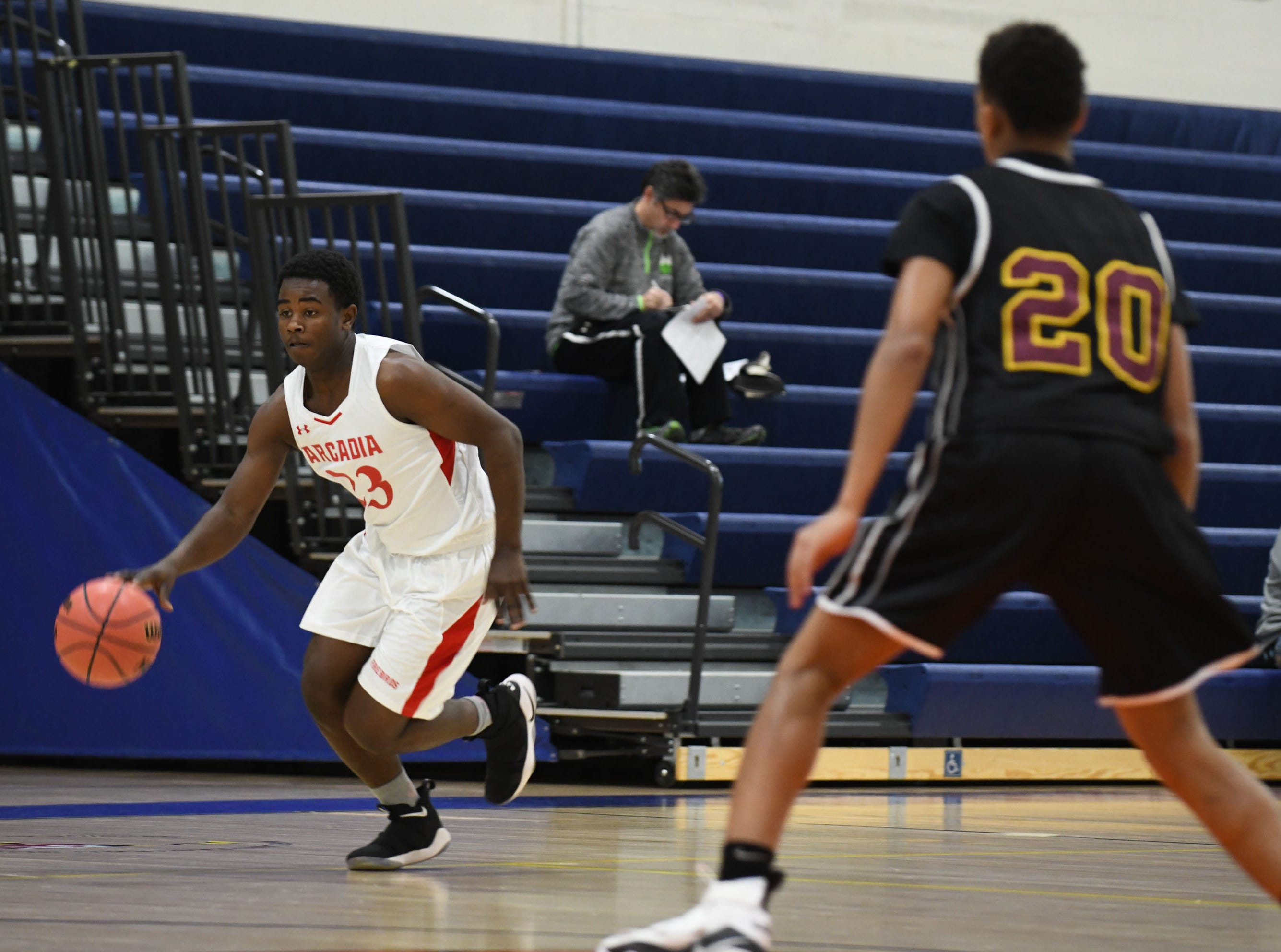 Arcadia's Kamron Downing brings the ball down the court against Washington High School on Wednesday, Dec. 26, 2018 during the Governors Challenge in Salisbury, Md.
