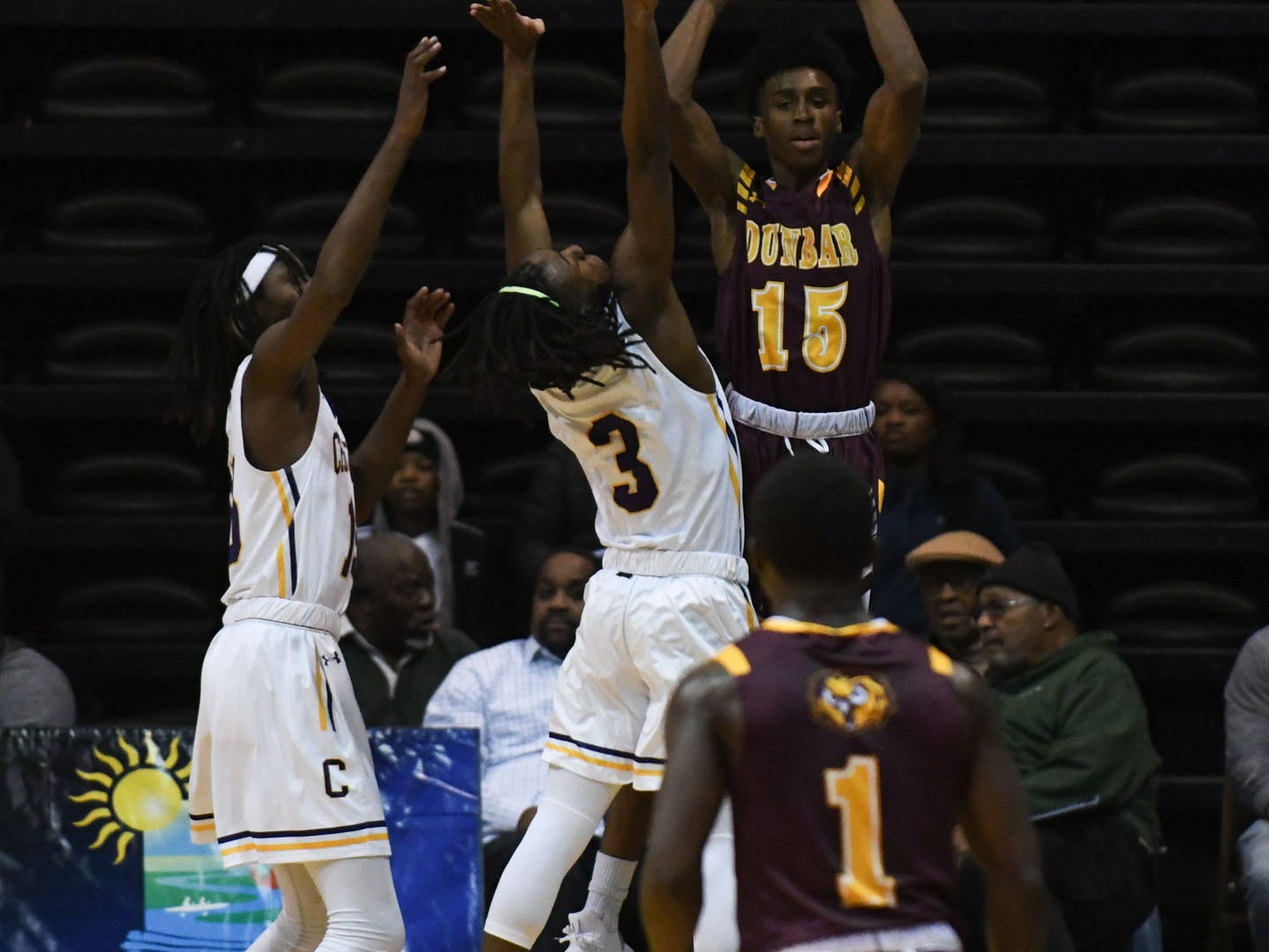 Dunbar's Sammy Davis Jr. is double teammed against Crisfield on Thursday, Dec. 26, 2018 during the Governor's Challenge in Salisbury, Md.